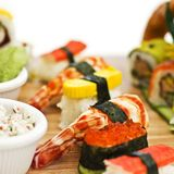 Japanese food - Sushi, sashimi, rolls on a wooden board. Isolate. Japanese food - Sushi, sashimi, rolls on the wooden board Stock Image