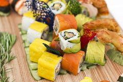 Japanese food - Sushi, sashimi, rolls on a wooden board. Isolate. Japanese food - Sushi, sashimi, rolls on the wooden board. Isolated Royalty Free Stock Photo