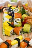 Japanese food - Sushi, sashimi, rolls on a wooden board. Isolate. Japanese food - Sushi, sashimi, rolls on the wooden board. Isolated Royalty Free Stock Images