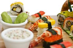 Japanese food - Sushi, sashimi, rolls on a wooden board. Isolate. Japanese food - Sushi, sashimi, rolls on the wooden board. Isolated Royalty Free Stock Image