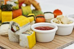 Japanese food - Sushi, sashimi, rolls on a wooden board. Isolate. Japanese food - Sushi, sashimi, rolls on the wooden board Royalty Free Stock Photo