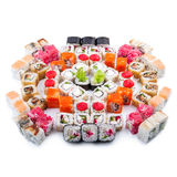 Japanese food. Sushi set of different rolls. Sushi set of different rolls on white table Royalty Free Stock Photos