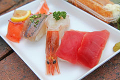 Japanese food, susi, grilled eel on rice. Japanese food, grilled eel on rice, susi, onion, sauce condiments stock photo