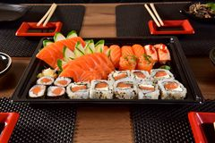 Japanese food to go. Mix of Japanese food on to go package stock photo