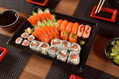Japanese food to go. Mix of Japanese food on to go package stock image