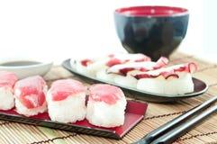 Japanese food - Tuna sushi  & Octopus sushi on the bamboo mat. Tuna sushi  & Octopus sushi on the bamboo mat Royalty Free Stock Photography