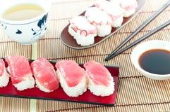 Japanese food - Tuna sushi  & Octopus sushi on the bamboo mat. Tuna sushi  & Octopus sushi on the bamboo mat Royalty Free Stock Images