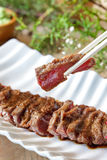 Japanese food wafu steak with chopsticks Royalty Free Stock Photos