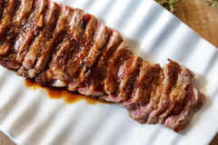 Japanese food wafu steak served on white plate with soy sauce, w Stock Photography