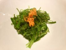 Japanese food. Wakame and Tobiko. Wakame is a sea vegetable, or edible seaweed. It has a subtly sweet flavour and is most often served in soups and salads stock image