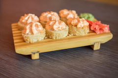 Japanese food on a wooden plate of sushi rolls with fish and ric Royalty Free Stock Photography