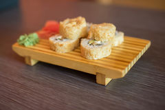 Japanese food on a wooden plate of sushi rolls with fish and ric Royalty Free Stock Photo