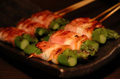 Japanese food - yakiniku. Bacon and aspara Royalty Free Stock Photography