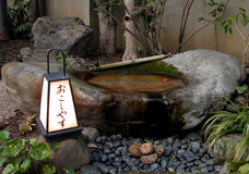 Japanese fountain. Traditional Japanese fountain Royalty Free Stock Photo