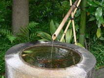 Japanese fountain. Japanese well and fountain in a stone royalty free stock photography