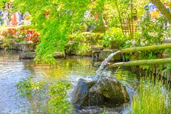 Japanese fountain and bamboo ladles Stock Photography