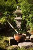 Japanese fountain. With stone decor and a bamboo tube Royalty Free Stock Photography