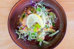 Japanese Fresh Salmon Salad on wooden background Stock Photos
