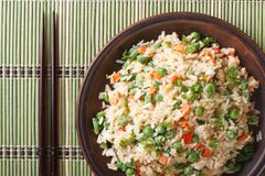 Japanese fried rice with egg, vegetables close-up top view Royalty Free Stock Photos