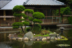 Japanese Garden. Showing a house and lake stock photography