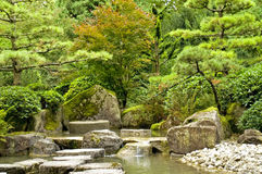 Japanese garden. A tranquil scene with rocks water and trees in the japanese garden in Augsburg, Germany stock image