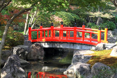 Japanese garden. Traditional red arch bridge in a Japanese garden Stock Photo