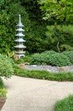 Japanese Garden. Pagoda Statue in Peaceful Japanese Garden Stock Photo