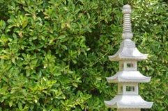 Japanese Garden. Pagoda Statue in Peaceful Japanese Garden Royalty Free Stock Photography