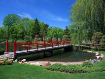 Japanese garden in Bloomington with red bridge Royalty Free Stock Photos