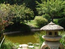 Japanese Garden in Botanical Garden, Cluj Napoca. Beautiful Japanese Garden in a hot summer day - Botanical Garden, Cluj Napoca, Romania. The chinese bridge over Stock Image