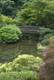 Japanese Garden Bridge. Footbridge over a pond in the Japanese Gardens stock image