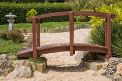 Japanese Garden Bridge. A Japanese garden bridge over a dry river of sand Stock Photo