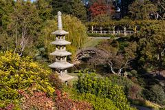 Japanese Garden Bridge. A Japanese garden bridge arcs over a pond in a hillside garden at the Huntington Library gardens in Pasadena, California royalty free stock images