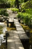 In the Japanese garden bridge. In the Japanese garden is a bridge that connects one and the other shore of a small lake Royalty Free Stock Photography