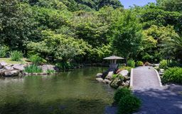 Japanese Garden covered by green Landscape. Taken in the wonderful Sengan-en Garden. Located in Kagoshima, Kyushu, South of Japan royalty free stock images