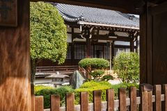 Japanese garden detail at a shrine in Gion, Kyoto. View from the street of a Japanese Garden detail in front of a Shrine Complex in Gion, Kyoto, Japan royalty free stock photo