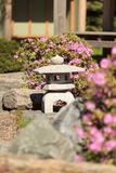 Japanese garden details. Stone sculpture. Eastern urn for incense. Royalty Free Stock Photography