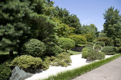 Rock, road , trees arranged in Japanese garden stock images