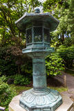 Japanese garden. Landscape with bronze lantern Stock Images