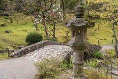 Japanese Garden. Lantern and bridge in a Japanese Garden Royalty Free Stock Image