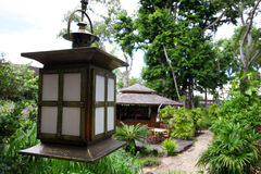 Japanese Garden. Oriental japanese garden on Hayman Island. Japanese lantern with restaurant in the background Royalty Free Stock Photos