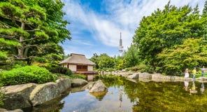 Japanese Garden (Planten un Blomen park) with Heinrich-Hertz-Turm, Hamburg, Germany. Beautiful view of Japanese Garden in Planten un Blomen park with famous Royalty Free Stock Images