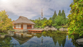 Japanese Garden in Planten un Blomen park with Heinrich-Hertz-Turm in Hamburg, Germany. Beautiful view of Japanese Garden in Planten un Blomen park with famous Royalty Free Stock Photos