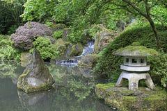 Japanese Garden Pond. Portland Japanese Garden Pond with Stone Lantern and Waterfall stock photo