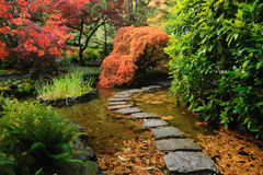 Japanese garden pond. Pond and path of the japanese garden inside the famous historic butchart gardens (built in 1903), vancouver island, british columbia stock photo