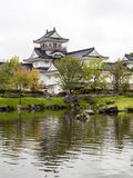 Japanese garden with pond and white castle Royalty Free Stock Image