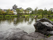 Japanese garden with pond and white castle Stock Images