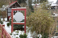 Japanese garden during snowfall in winter Stock Photography