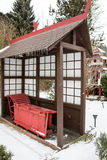 Japanese garden during snowfall in winter Royalty Free Stock Photo
