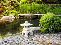 Japanese garden. Stone lantern placed among the flowers in Japanese garden. Royalty Free Stock Images